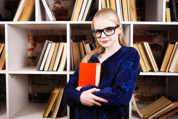 Teenage girl in a library