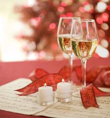 Holiday white wine against defocused lights
