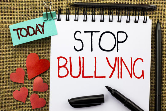 Writing note showing  Stop Bullying. Business photo showcasing Do not continue Abuse Harassment Aggression Assault Scaring written on Notebook Book on the jute background Today Hearts and Pens