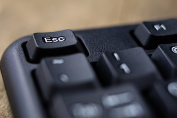 An enlarged computer keyboard. Black keyboard buttons for the computer.