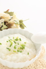 Chinese food, soy sauce and spring onion on congee