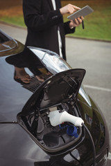 Car being charged with electric car charger