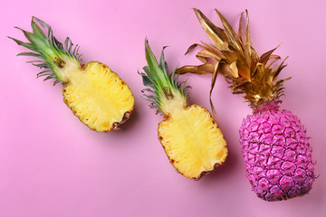 Fresh pineapples on color background, flat lay