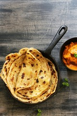 Homemade Kerala wheat paratha or layered  parotta  served with Paneer curry, top view
