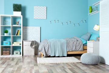 Comfortable bed in modern children room