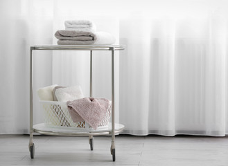 Cart with clean towels indoors