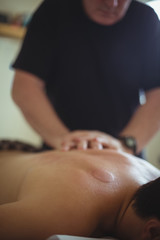 Man receiving massage from therapist