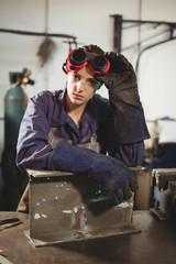 Female worker sitting in workshop