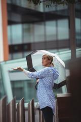 Beautiful woman enjoying rain
