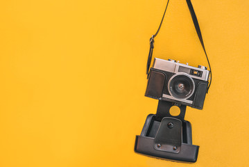 Vintage camera isolated at orange wall
