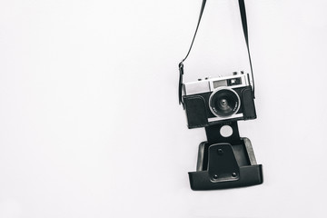 Vintage camera isolated at white wall