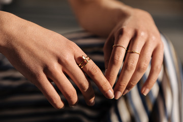 Crop woman hands with rings on the street