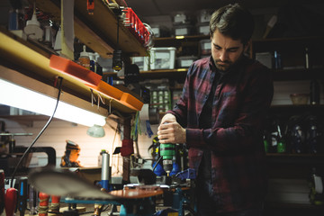 Man fixing ski binding on ski