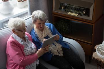 Senior friends using digital tablet