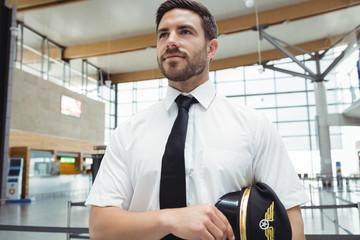 Pilot standing in airport terminal
