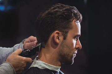 Man getting his hair trimmed with trimmer