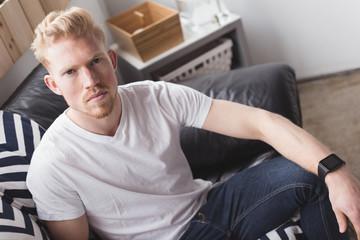 Portrait of man on sofa