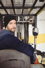 Portrait of man sitting in forklift truck