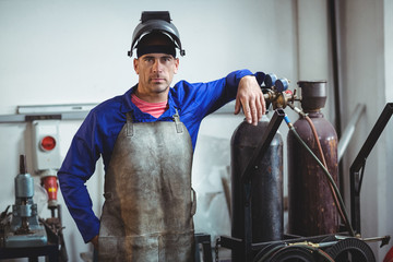 Portrait of male welder standing