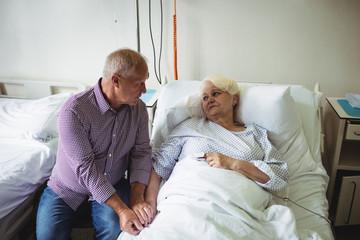 Senior man consoling senior woman