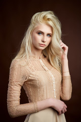 Portrait of beautiful young blonde girl Fashion photo