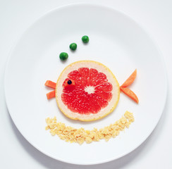 stock-photo-fish-from-fruit-grapefruit- healthy-and-fun-food-for-kids -on-white-plate-top-view