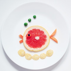 stock-photo-fish-from-rape-citrus-fruit- healthy-and-fun-food-for-kids-on-white-plate-top-view