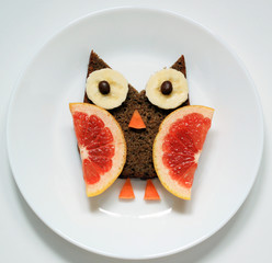 stock-photo-owl-from-fruit-funny-food-art-for-breakfast-for-kids-on-white-plate