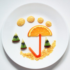 stock-photo-summer-beach-umbrella-cocktails-from-fruit-funny-and- healthy-food-for-children-on-plate