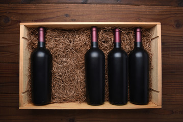 Wood case of red wine bottles with one missing