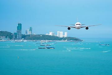 Airplane flying over the sea in Pattaya, Bangkok