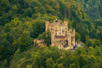Castle Hohenschwangau in Germany. The Royal Palace in Bavaria. The yellow famous palace is a tourist attraction.
