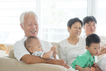 Asian family relaxed at home