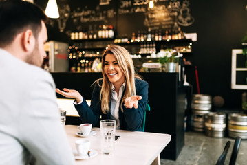 Smiling blonde businesswoman enjoying on a first date.