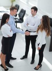handshake business partners before the talks