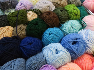 collection of multi colored wool knots