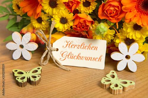 Blumen Und Karte Herzlichen Glückwunsch Stock Photo And