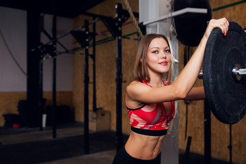 Image of athlete woman with barbell