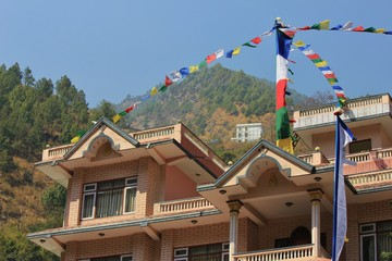 Prayer flags on top of a roof in Syabru Besi, Langtang National Park, Nepal.
