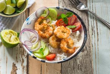 Tandoori prawns with rice and chopped salad - high angle view