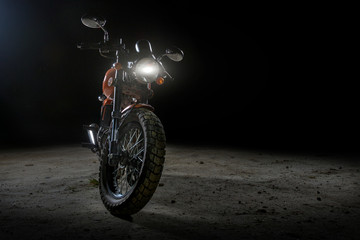 Motorbike under back lit light,black background