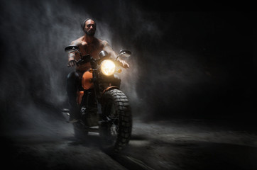 Stylish motorcycle chopper with exclusive man rider at night on the road