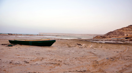 A boat on the lonely beach