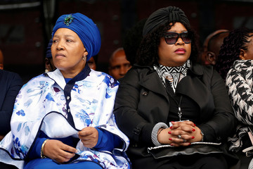 Winnie Madikizela-Mandela's daughters Zenani and Zindzi attend a memorial service for their mother at Orlando Stadium in Johannesburg's Soweto township