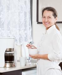 woman in   kitchen  near  coffee machine.
