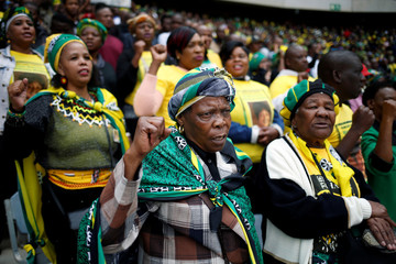 Mourners attend a memorial service for Winnie Madikizela-Mandela at Orlando Stadium in Johannesburg's Soweto township