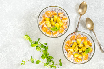 Chia pudding with coconut milk, mango and mandarin