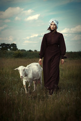 Amish styled model is posing with animals
