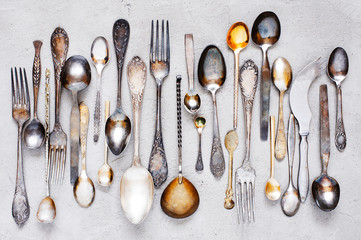 Vintage silverware lying on the grey table