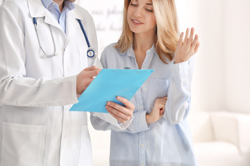 Doctor consulting female patient in clinic